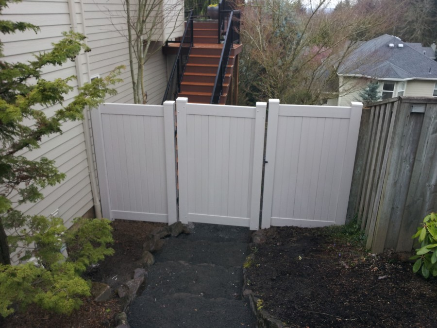 Grey PVC privacy fence and gate