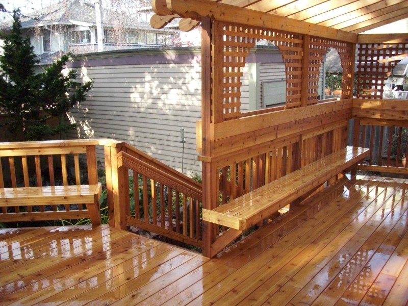 Custom cedar benches, flower boxes, and pergola