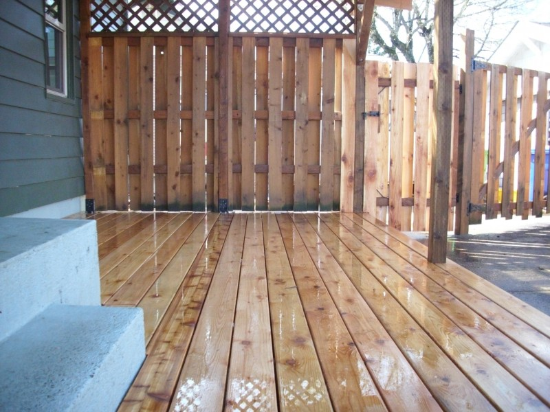 Cedar deck w polycarbonate patio cover and recycled gates for Wood privacy screens for decks