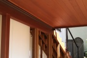 Tongue and groove meranti ceiling stained in dark walnut