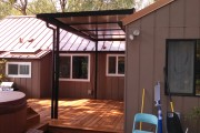 Composite deck and patio cover