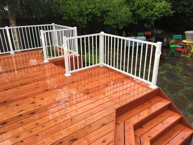 Cedar deck with aluminum railing in white