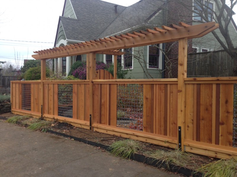 Cedar and woven wire fence with pergolas | Deck Masters, llc ...