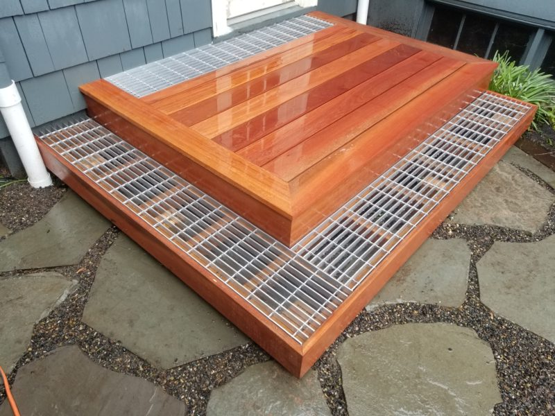 Hardwood deck with aluminum grates