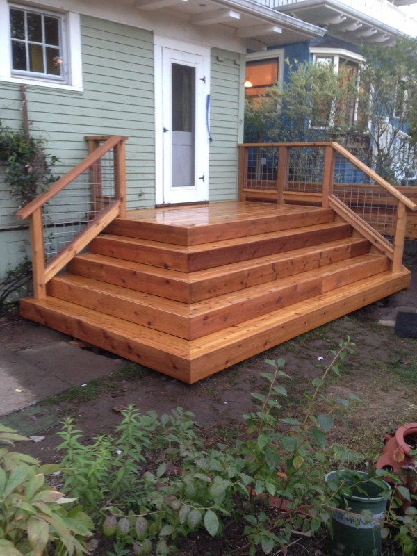 Cedar deck and hog panel rail