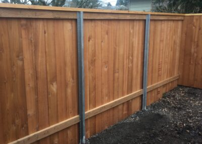 Cedar fence with metal posts