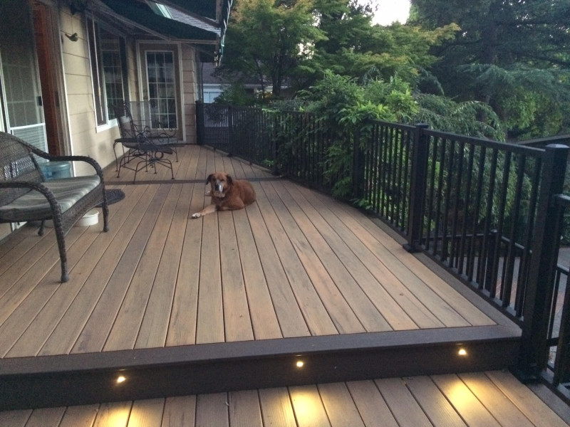 Composite deck with aluminum railing