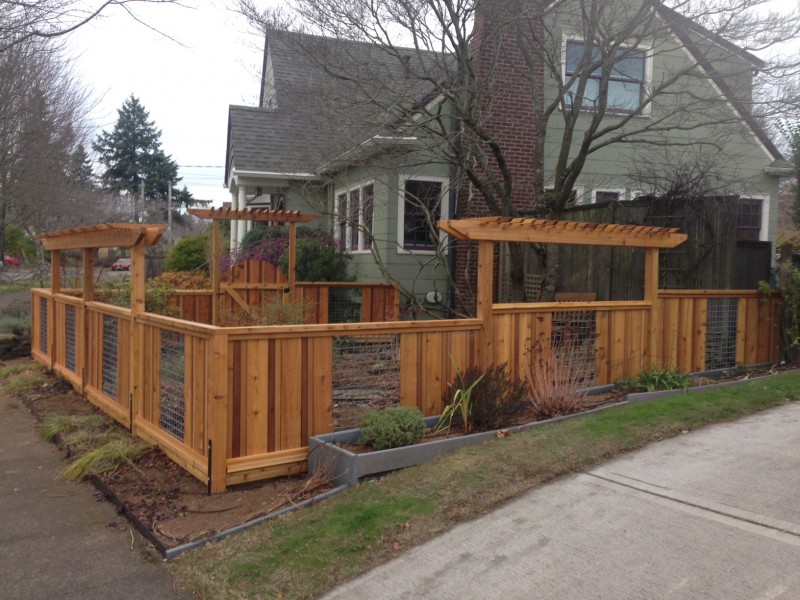 Cedar and woven wire fence with pergolas